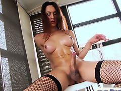 Brunette tranny tugs on her hard cock