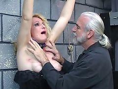 Old blonde milf gets strapped in for some discipline