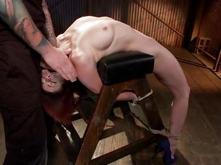 bound slut is face fucked while she is in the dungeon