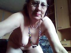 Kinky hairy granny enjoys peeing in the bucket