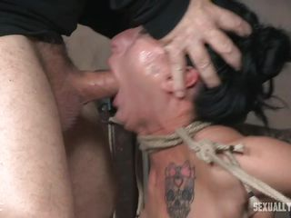 hot sex slave has a cock in hand and one in her mouth