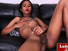 Tattooed ladyboy wanks her hung cock solo