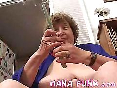 Horny granny masturbates with objects