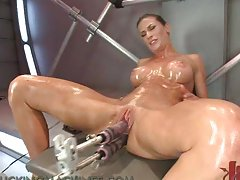 Hot Babe Works Up A Hot Sweat As She Gets Drilled By A Fucking Machine