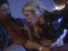 Horny blonde in latex dress sucks a big cock