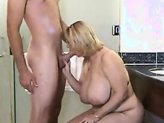 Mature big tits suck