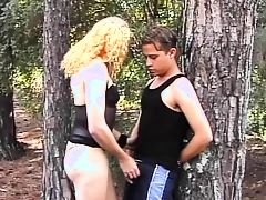 Skanky blonde tranny sucks young guys cock in the woods